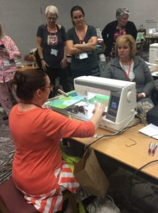 Liz teaching us about the quilt binder attachment